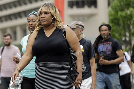 Tanya Brown-Dickerson, the mother of Brandon Tate-Brown who was shot by Philadelphia police as he ran during a traffic stop, arrives for a news conference Monday, June 15, 2015, outside of City Hall in Philadelphia. Brown-Dickerson is suing the city over the fatal shooting of her son last December.  (AP Photo/Matt Rourke)