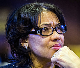 Flint Mayor Karen Weaver listens as Genesee County board Chairman Jamie Curtis speaks Monday, Jan. 4, 2016, in Flint, Mich. Curtis, supported by the board, declared a state of emergency Monday as plans move forward to seek more help handling problems with Flint's water system. (Jake May/The Flint Journal-MLive.com via AP)