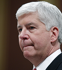 Michigan Gov. Rick Snyder pauses as he delivers his State of the State address to a joint session of the House and Senate, Tuesday, Jan. 19, 2016, at the state Capitol in Lansing, Mich. With the water crisis gripping Flint threatening to overshadow nearly everything else he has accomplished, the Republican governor pledged a fix Tuesday night during his annual State of the State speech. (AP Photo/Al Goldis)