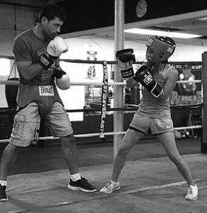 Mia sparring with her boxing coach, Marc Gargaro of Nonantum Boxing Club