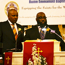 Pastor Darrian A. Brown (at left), incoming president of the BPMC, standing next to outgoing president, Bishop Sutton.