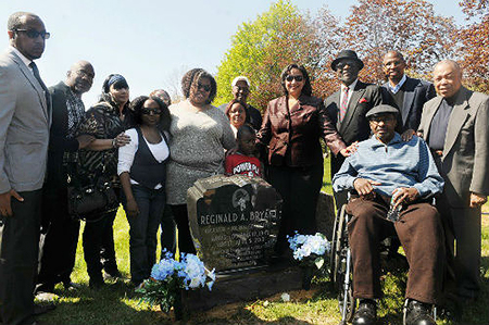 Acel Moore in wheelchair at Reggie Bryant's grave stone unveiling in 2013. To his left is NABJ founder Les Payne; to his right is Paul Brock, NABJ's first executive director.    Photo courtesy: NABJ