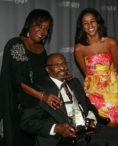Linda Wright Moore, left, with her husband Acel Moore and their daughter Mariah. Acel was given the Lifetime Achievement Award at the Salute to Excellence Gala during the 2011 National Association of Black Journalists Convention in Philadelphia.   Photo courtesy: NABJ