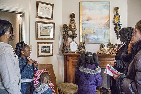 Families enjoy exhibit artifacts in the museum.  (Photo: Courtesy of Colored Girls Museum)