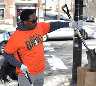 Robert Philips from Vision of Hope Baptist Church assist in the North Broad Clean Up during the 9th Annual Philly Spring Clean Up