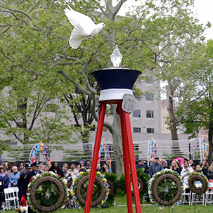When doves fly….One of three doves takes flight today at Franklin Square Park at the close of the annual Police & Fire Living Flame Memorial Service to honor more than 500 police officers and firefighters who sacrificed their lives in service over the years.  (Photo by Tony Webb, City of Philadelphia/ Office of the City Representative)