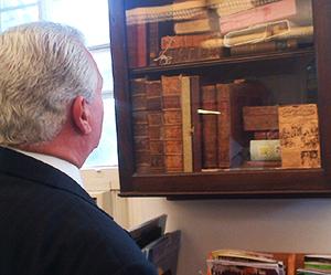 Congressman Brady inspects rare book collection at historic Darby Library.  (Photo Courtesy of Cong. Bob Brady)