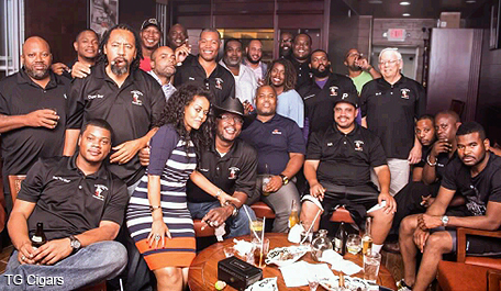 TG Cigar Lounge founder Negest Dawit poses with members of the Good Time Gang Cigar Club.  (Photo: Mark Jackson)