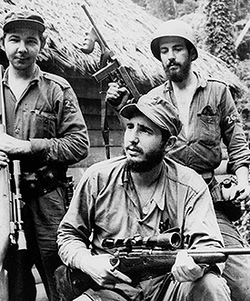 In this March 14, 1957 file photo, Fidel Castro, the young anti-Batista guerrilla leader, center, is seen with his brother Raul Castro, left, and Camilo Cienfuegos, right, while operating in the Mountains of Eastern Cuba. Cuban President Raul Castro has announced the death of his brother Fidel Castro at age 90 on Cuban state media on Friday, Nov. 25, 2016.(AP Photo/Andrew St. George, File)