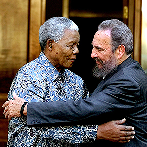 Former South African President Nelson Mandela and Cuban leader Fidel Castro embrace during a visit by Castro Sunday, Sept. 2, 2001 in Johannesburg, South Africa.  Castro was in Durban, South Africa to participate in the World Conference Against Racism. (AP Photo/Jose Goitia)